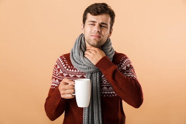 Portrait of a sad young man dressed in sweater