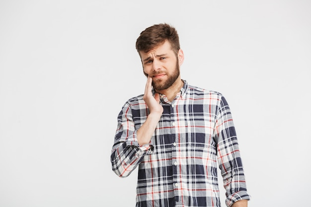 Portrait of a sad young man in plaid shirt