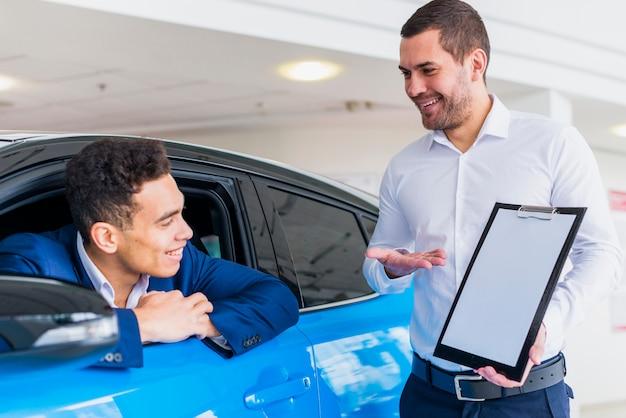 Portrait of salesman in car dealership