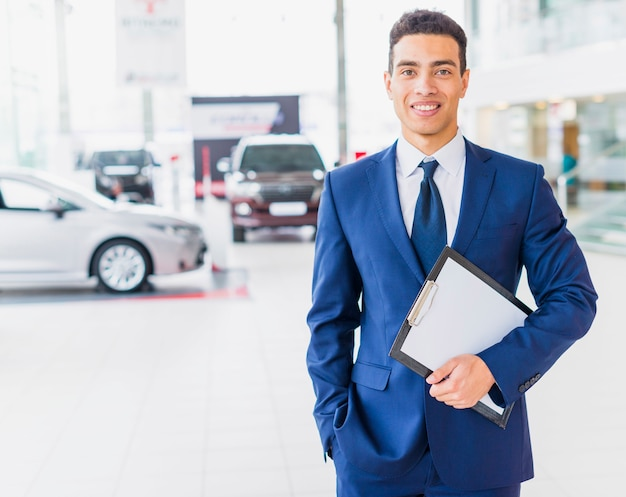 Portrait of salesman in car dealership