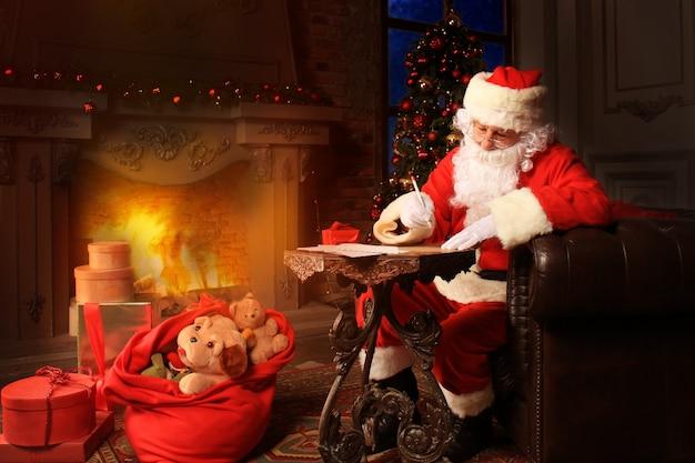 Portrait of santa claus answering christmas letters.