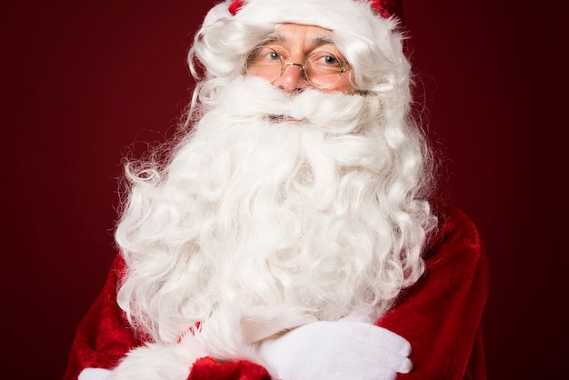 Portrait of santa claus on red background