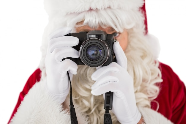 Portrait of santa taking a photo
