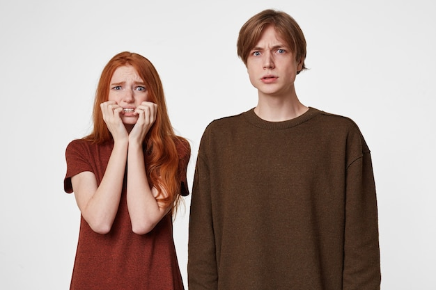 Portrait of scared couple