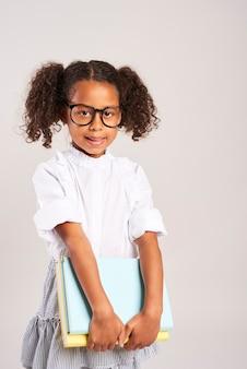 Portrait of schoolgirl holding books