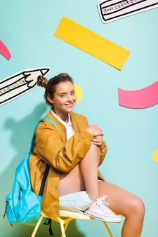Portrait of schoolgirl on a memphis background