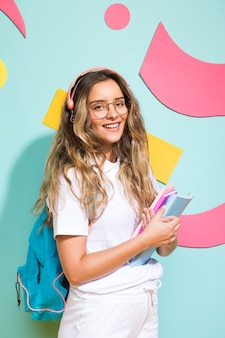 Portrait of schoolgirl on memphis style background