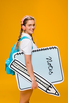 Portrait of schoolgirl with big notepad template