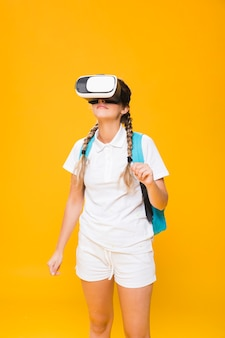 Portrait of schoolgirl with vr glasses