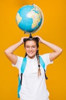 Portrait of schoolgirl on yellow background