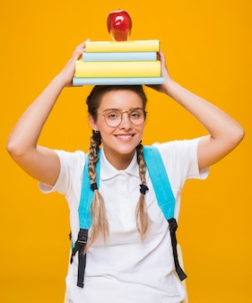Portrait of schoolgirl on yellow background