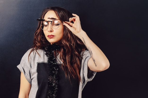 Portrait of seductive hipster woman wearing glasses