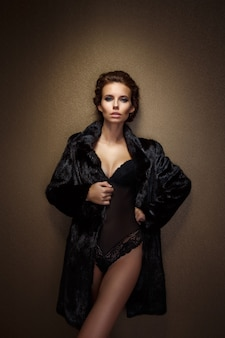 Portrait of a seductive lady in fur coat
