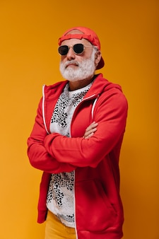 Portrait of self confident man in red cap and sunglasses