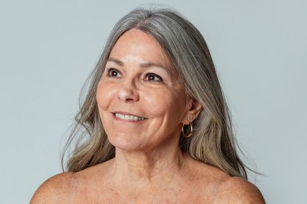 Portrait of a semi-nude beautiful senior woman