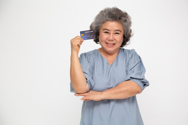 Portrait of senior asian woman holding credit card and showing on hand