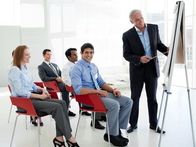 Portrait of a senior businessman giving a conference