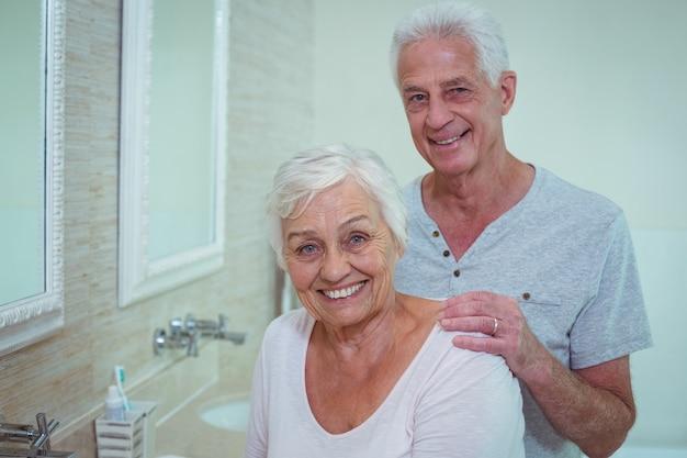 Portrait of senior couple in bathroom