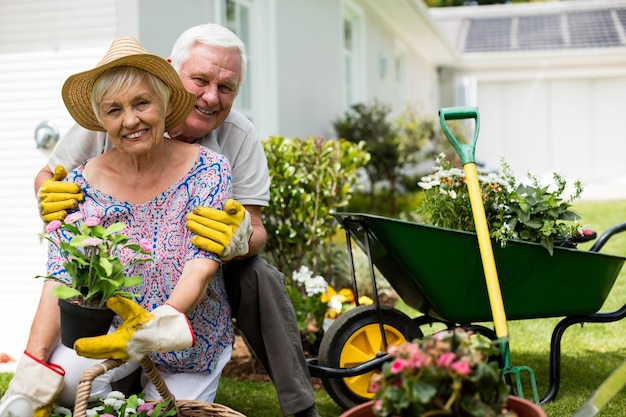 Portrait of senior couple embracing each other in backyard