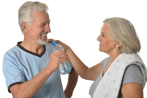 Portrait of  senior couple  with water after exercising isolated on white