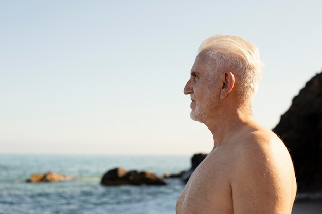 Portrait of senior gray-haired man at the beach