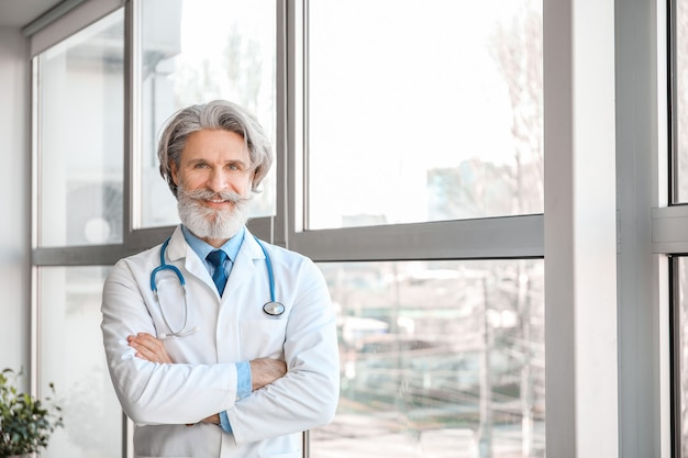Portrait of senior male doctor in clinic