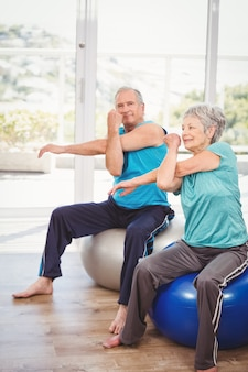 Portrait of senior man exercising with wife