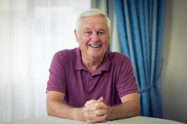 Portrait of senior man sitting in medical clinic