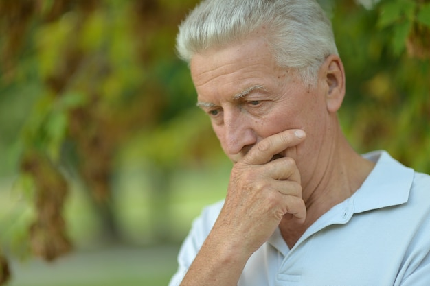 Portrait of senior man thinking about something outdoor