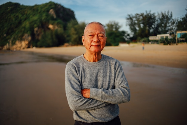 Portrait of senior old man relax on the beach smile and happy face