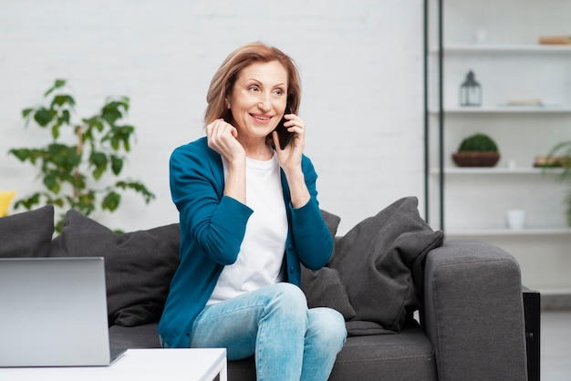 Portrait of senior woman talking on the phone