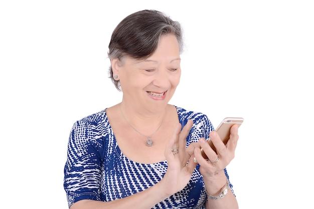 Portrait of senior woman texting