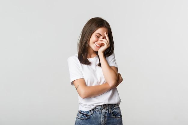 Portrait of sensual beautiful brunette girl flirty smiling and blushing.