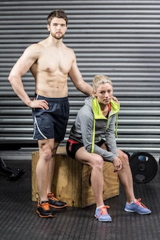 Portrait of serious athletic couple at crossfit gym