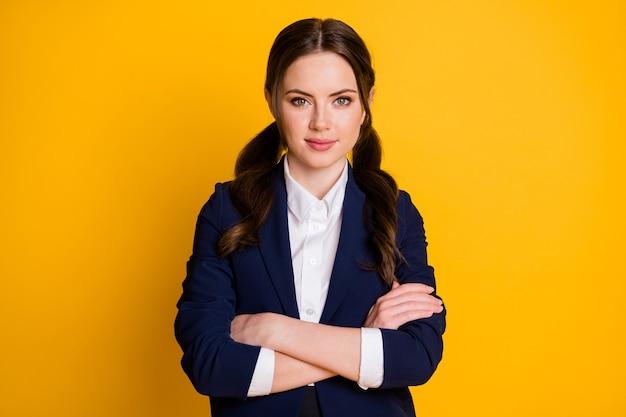 Portrait of serious charming high school girl cross hands