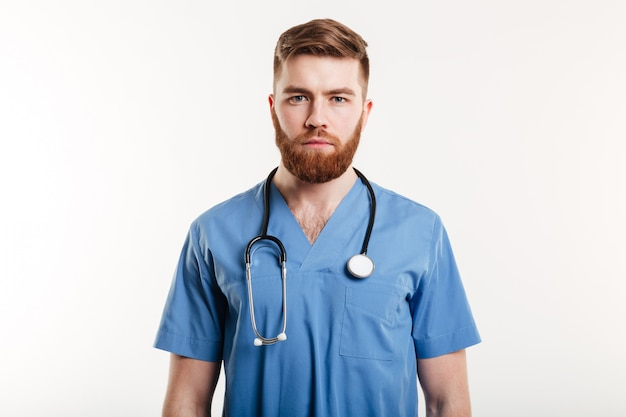 Portrait of a serious confident male doctor standing