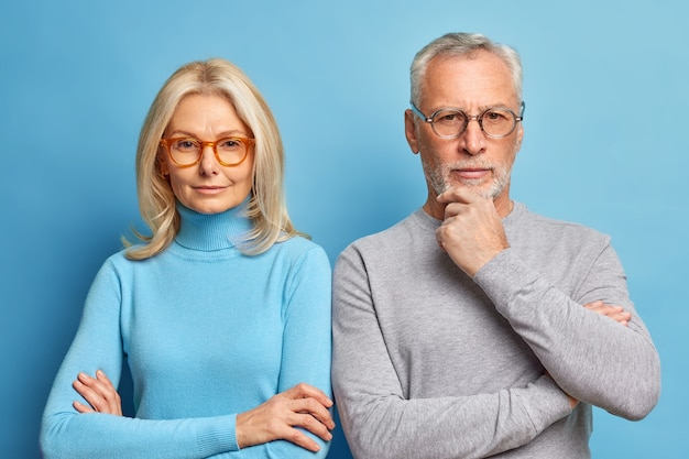 Portrait of serious husband and wife pose together in casual clothes make photo for long memory