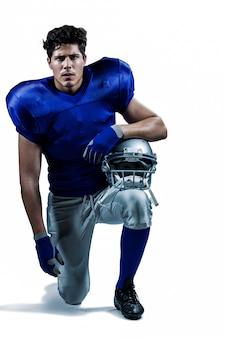 Portrait of serious sportsman holding helmet