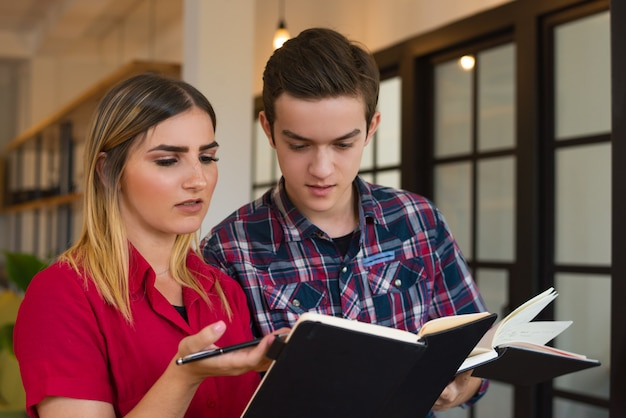 Portrait of serious student boy and girl discussing lecture