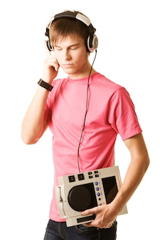Portrait of serious young guy with headphones