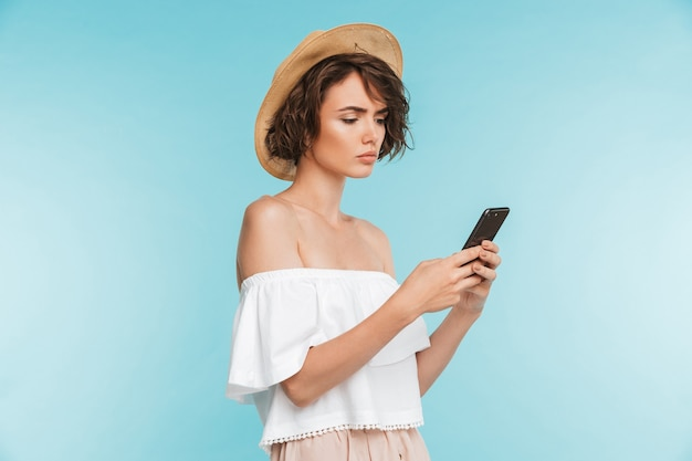 Portrait of a serious young woman using mobile phone