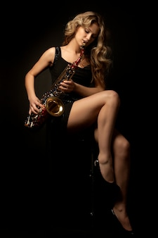 Portrait of sexy attractive women with saxophone