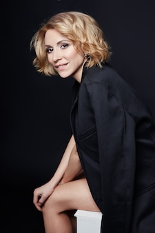 Portrait sexy business woman blonde in black dress