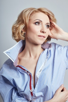 Portrait sexy business woman blonde in blue shirt