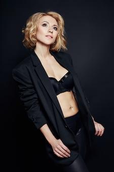 Portrait of sexy business women blonde in jacket