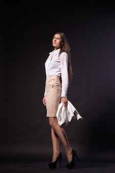 Portrait of sexy elegant woman on dark background. fashion photo