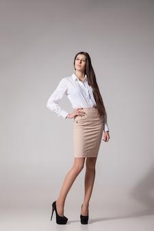 Portrait of sexy elegant woman on grey background. fashion photo