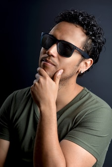 Portrait of sexy latin man with sunglasses