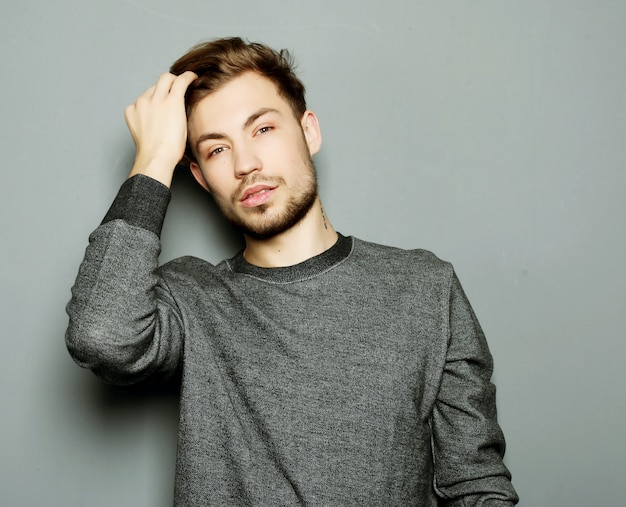 Portrait of sexy man over grey background