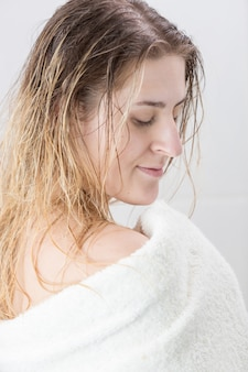 Portrait of sexy woman with long hair in towel